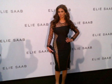 Elissa attending the Elie Saab show in Paris dress ed in a sexy black cocktail dress by British  fashion designer  Stella Mc Cartney.