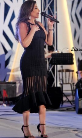 Elissa wears a black dress by David Koma matched with black stilettoes by Valentino at her second performance in Tunis in 2019.